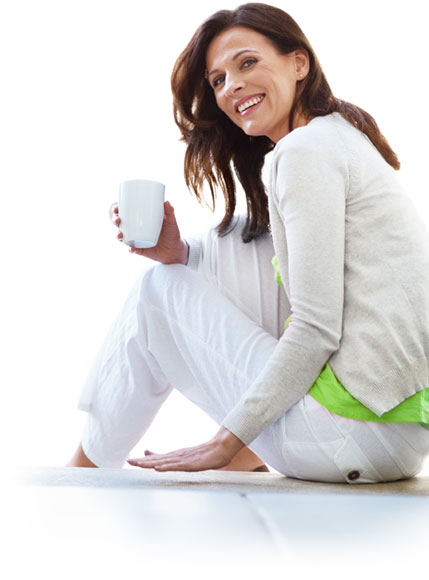 Woman sitting and smiling and having coffee